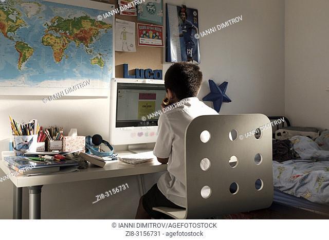 UK,Surrey-Schoolboy-11 years old, studies nin his room