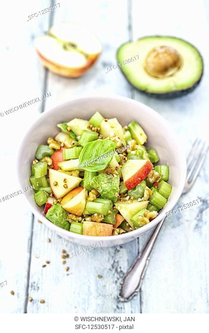A salad with apples, celery, avocado and walnuts (low carb lunch)