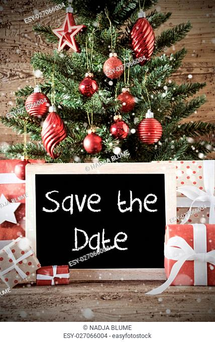 Chalkboard With English Text Save The Date. Nostalgic Christmas Card For Seasons Greetings. Christmas Tree With Balls. Gifts Or Presents In The Front Of Wooden...