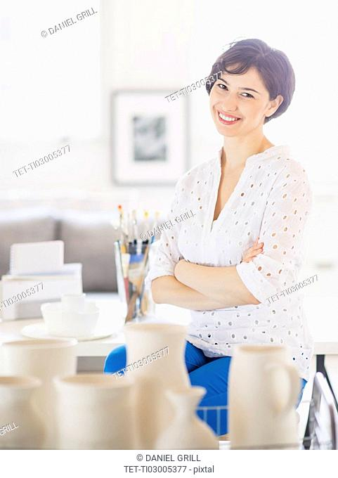 Portrait of smiling woman in art studio