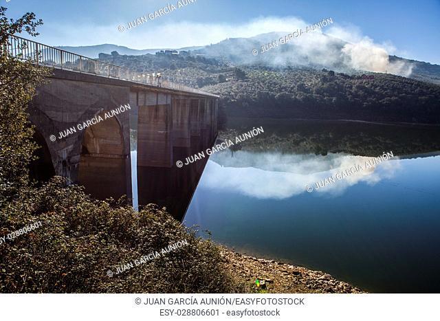 La Pesga bridge over Gabriel y Galan Reservoir waters, Caceres, Spain. Local people crossing the bridge