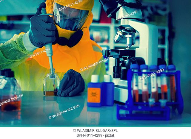 Person wearing protective clothing working in a laboratory