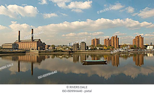 Cityscape with industrial buildings on River Thames, Chelsea, London