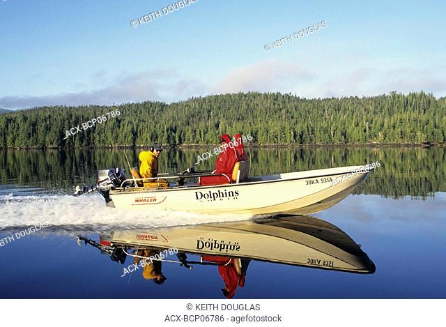 Boat speeding along inlet, Work Channel, British Columbia, Canada