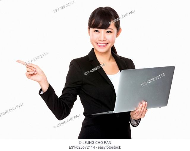 Young businesswoman hold with laptop computer and finger point aside