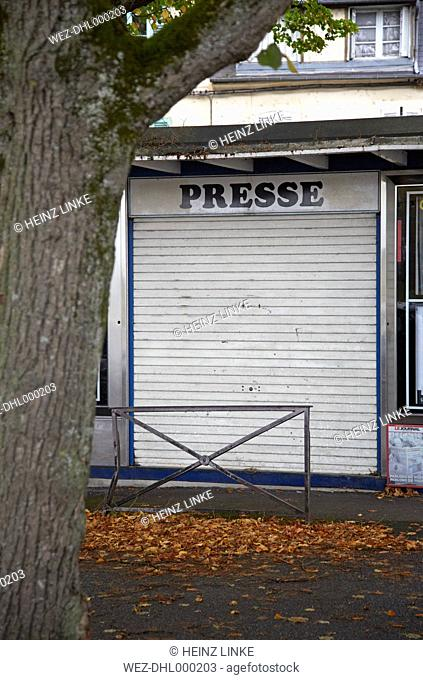France, Burgundy, Nevers, Abandoned newspaper stand