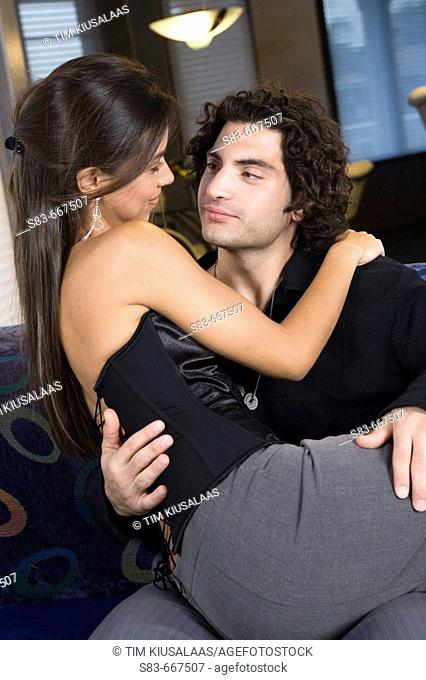 Young couple on couch in club