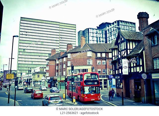 Traffic, red bus in a street. High Street, Croydon, London, England, Great Britain, United Kingdom