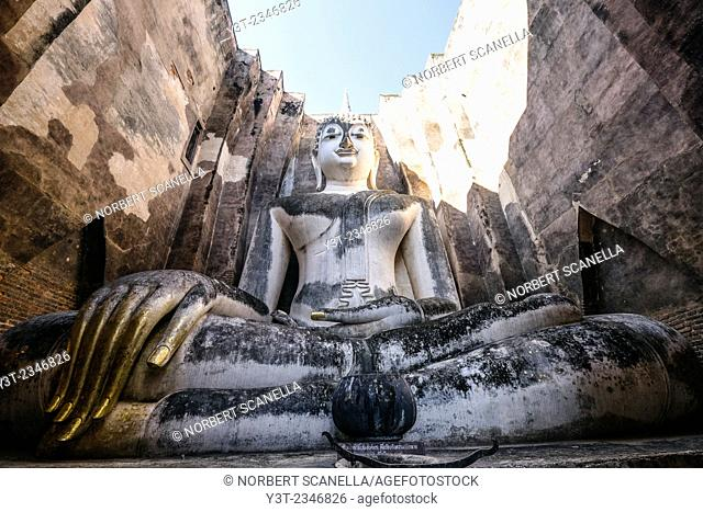 Asia. Thailand, old capital of Siam. Sukhothai archaeological Park, classified UNESCO World Heritage. Wat Si Chum. Buddha statue