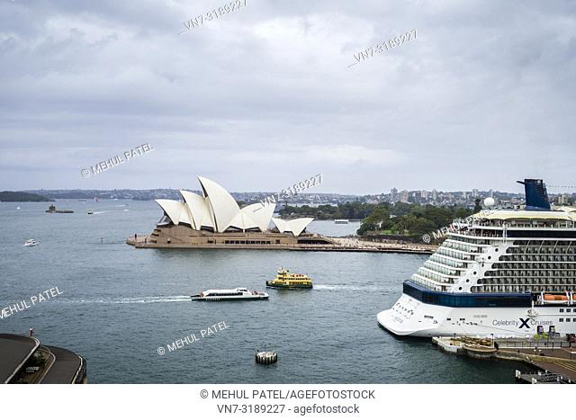 Sydney Harbour with iconic Sydney Opera House in view and large cruise liner docked at the Overseas Passenger Terminal, Circular Quay, Sydney, New South Wales