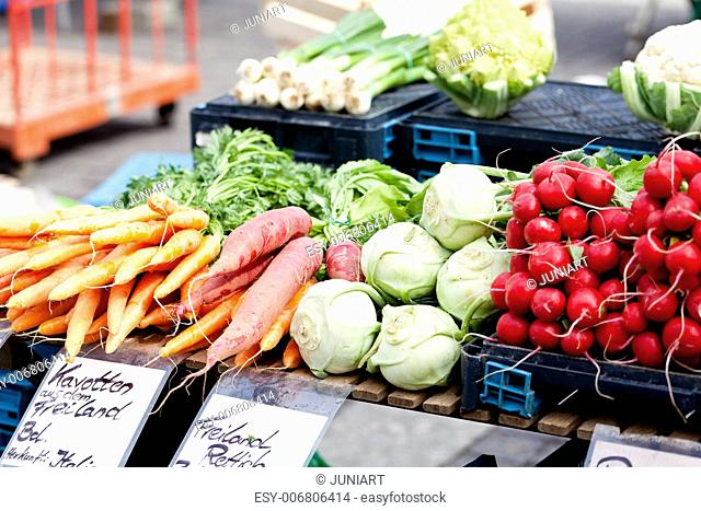 fresh healthy vegetables on market in summer outdoor