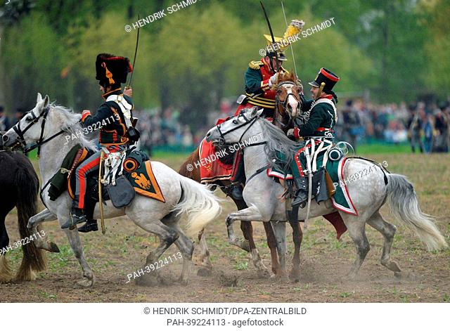 Napoleonic and Russian and Prussian troops stand opposite to each other in a historical battle representation with more than 2