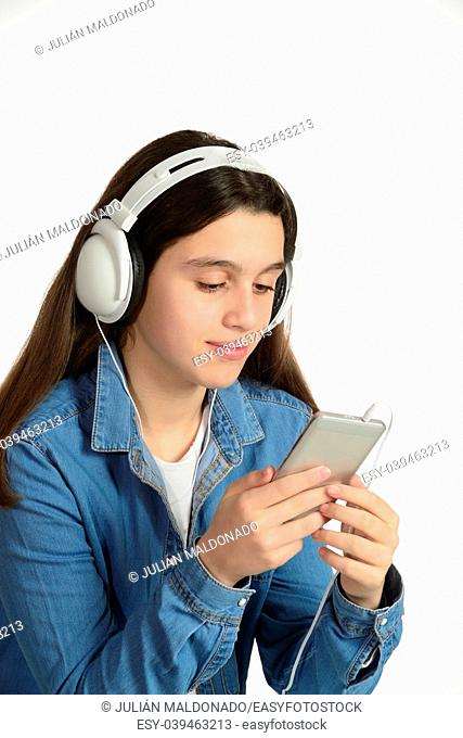 Young teenager with his headphones, listening to music through the mobile