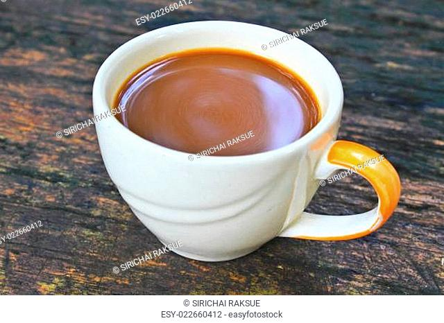 hot coffee in white cup on a wooden table