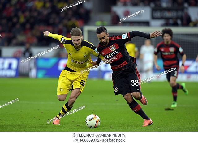 Leverkusen's Karim Bellarabi (R) and Dortmund's Lukasz Piszczek in action during the Bundesliga soccer match between Bayer 04 Leverkusen and Borussia Dortmund...