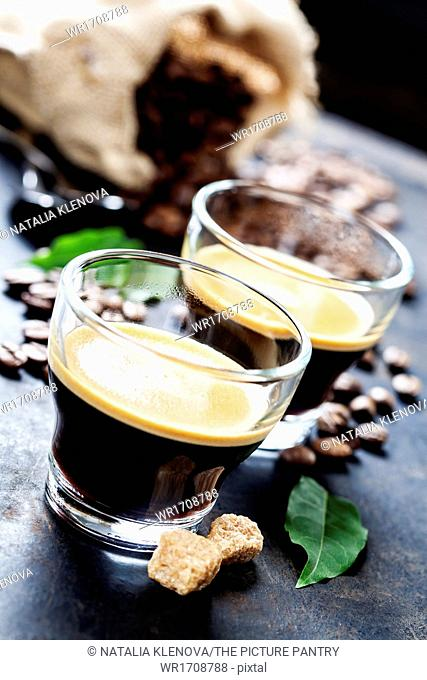 Cups of Espresso on dark rustic background