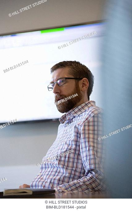 Caucasian businessman talking in office meeting