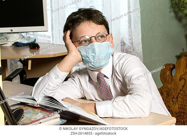 A boy suffering from flu learns lessons at home