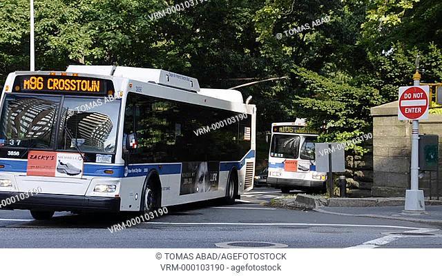 MTA public bus traversing central park via Central Park, New York City