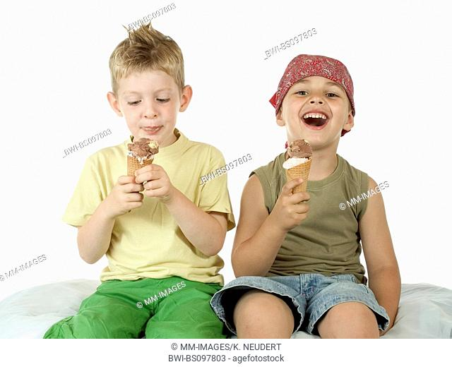 two boys eating an ice cream, Germany