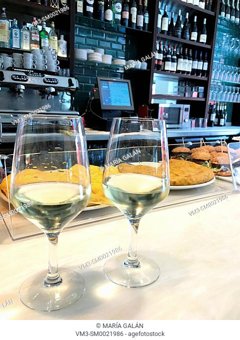 Two glasses of white wine in a bar. Santander, Spain