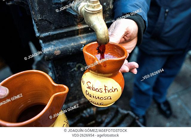 During the festival of San Sebastian in Reinosa (Cantabria) of the fountain in the square wine out. REINOSA-CANTABRIA-SPAIN