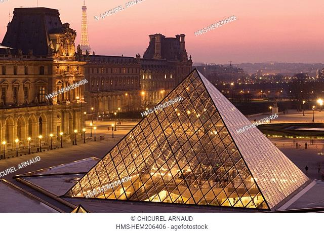 France, Paris, the Louvre museum and Louvre Pyramid by architect Ieoh Ming Pei with the Eiffel Tower illuminated lighting of the Eiffel Tower by Pierre Bideau
