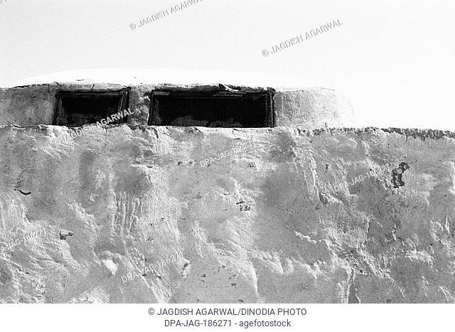 Mud wall and iron grill window Sam Khuri village Jaisalmer Rajasthan India Asia 1984