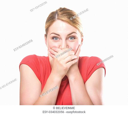 Laughing blonde woman in red t-shirt covers mouth with hand, isolated on white