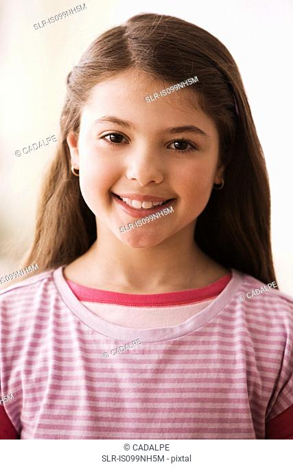Portrait of young girl, smiling