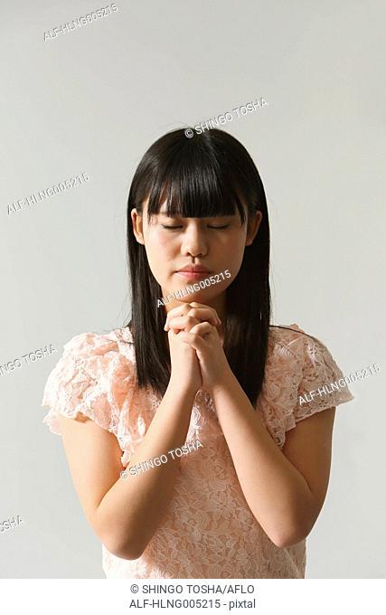Japanese young woman praying