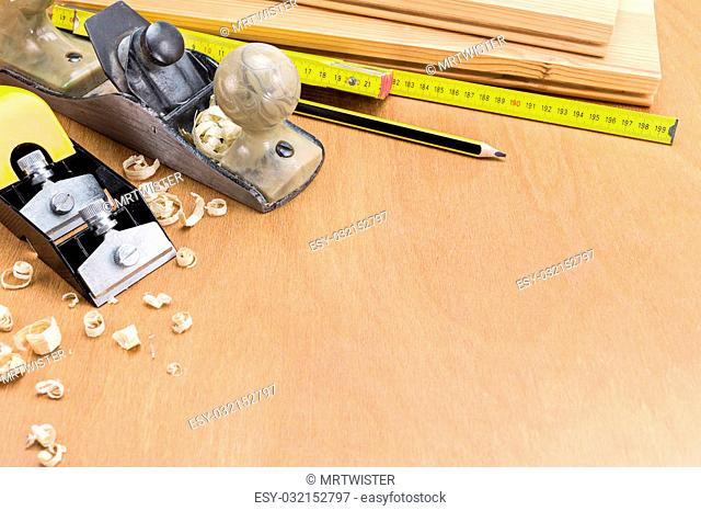 Set of carpenter working tools on wood and shavings