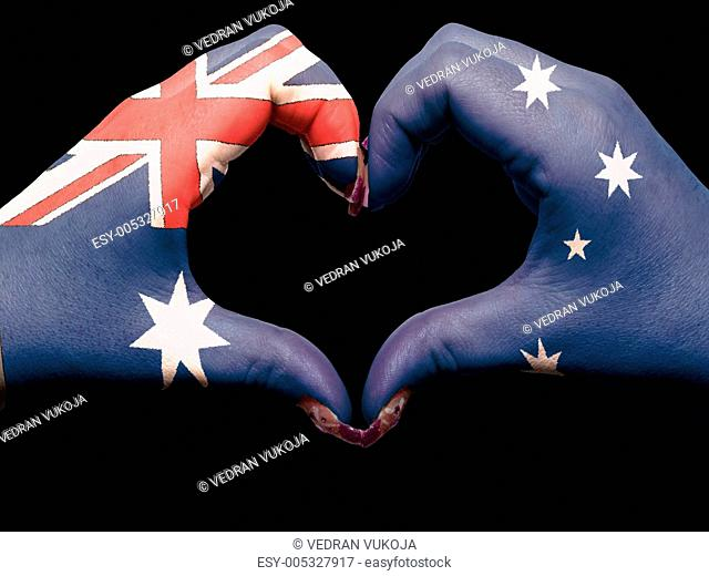 Heart and love gesture by hands colored in australia flag for t