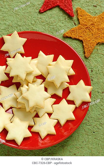 Star Shaped Cookies On A Red Plate