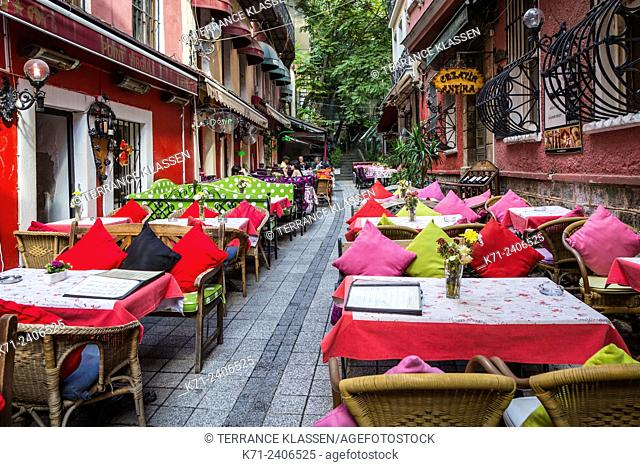 Colorful restaurants with tables and chairs and the unique Cezayir or French Street in Taksim, Istanbul, Turkey, Eurasia