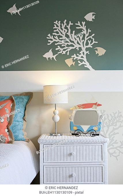 Wall decal above side table and bed at home