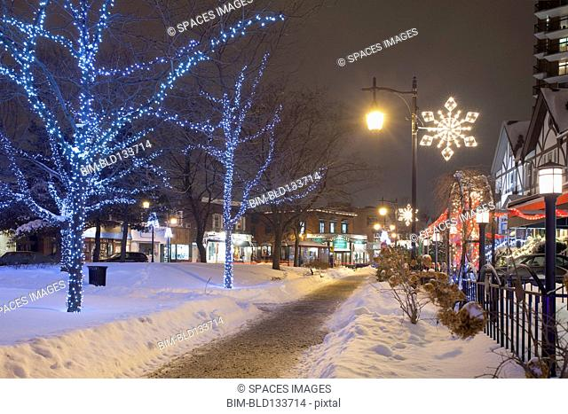 Christmas lights on snowy St Lambert street at night, Quebec, Canada