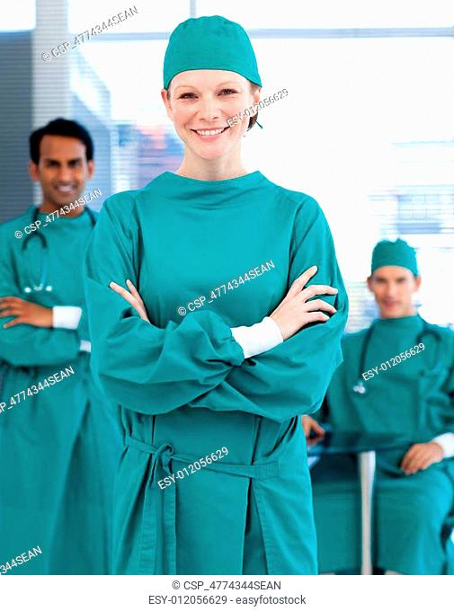 Confident surgeons smiling at the camera