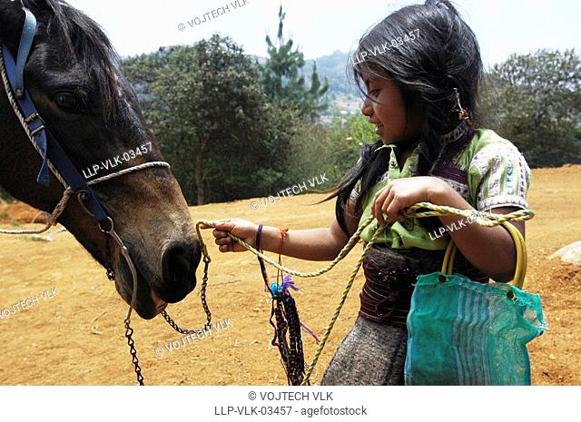 Mexican girl with her horse
