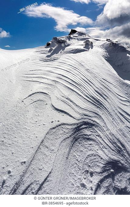 Overhanging snow with wind grooves or Sastrugi ridges, at Mt Wildkamm, Niederalpl, Mürzsteg Alps, Styria, Austria