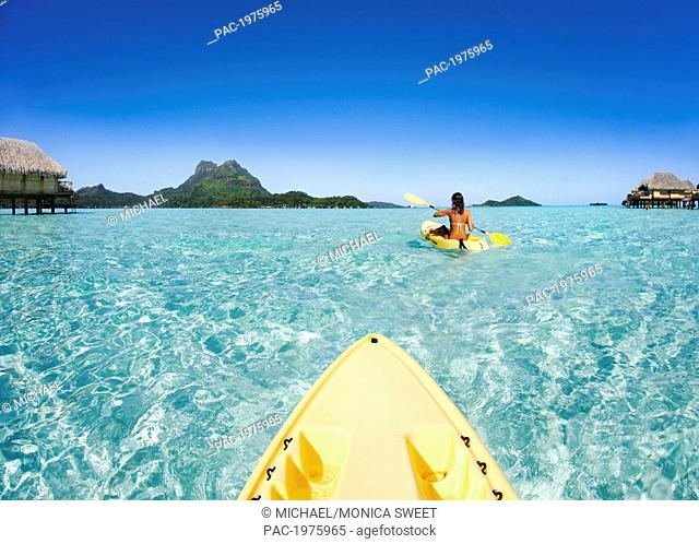 French Polynesia, Bora Bora, Female Kayaker Enjoying A Day On The Water