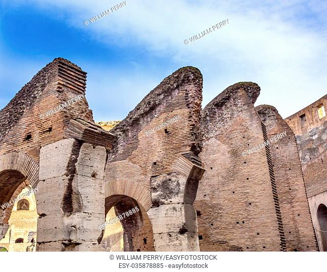 Arches Bricks Concrete Building Materials Construction Colosseum Rome Italy. Built by Emperors Vespasian and Titus in 80 AD with sand and concrete largest...