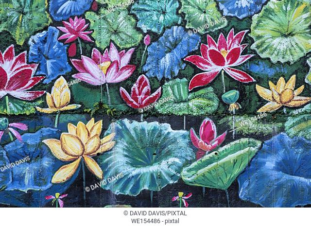 Beautiful outdoor mural of water lilies