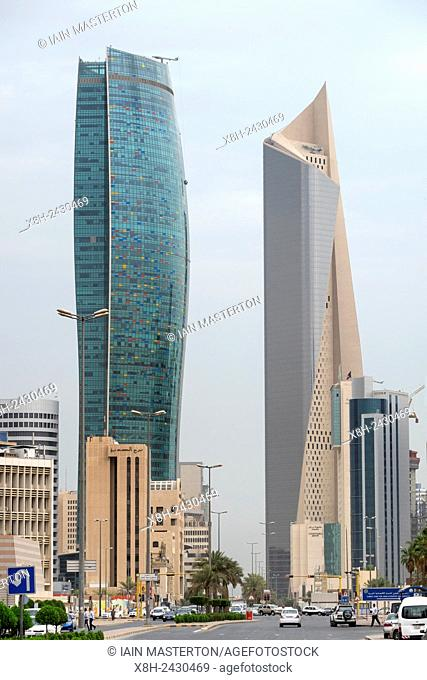 Modern skyscrapers (Kipco Tower on left and Al Hamra Tower) in Central Business District CBD of Kuwait City , Kuwait
