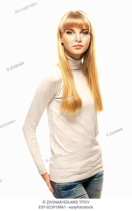young woman in gray sweater and jeans