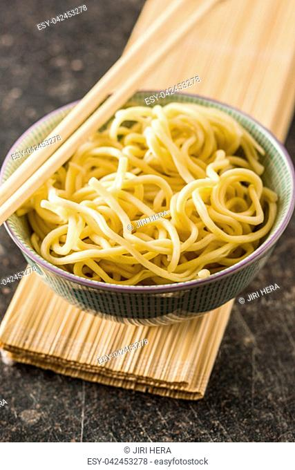 Cooked chinese noodles in bowl