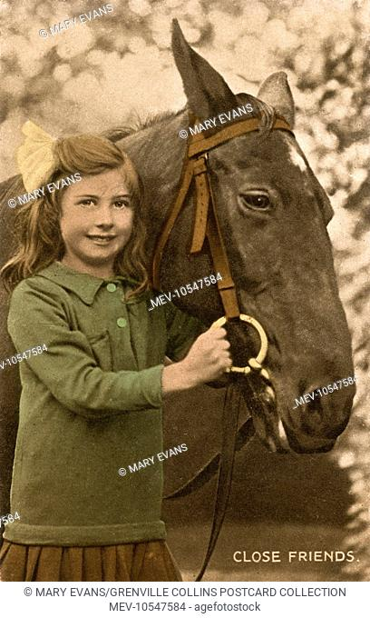 Close Friends - a little girl holding on to the head of her favourite horse
