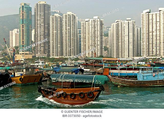 High-rise buildings towering over Aberdeen Harbour, Sampan boat harbour, at Aberdeen Channel