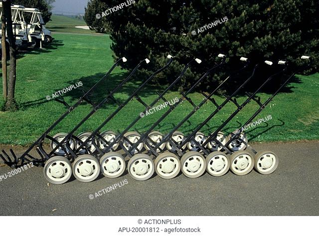 Group of pull carts by a golf course