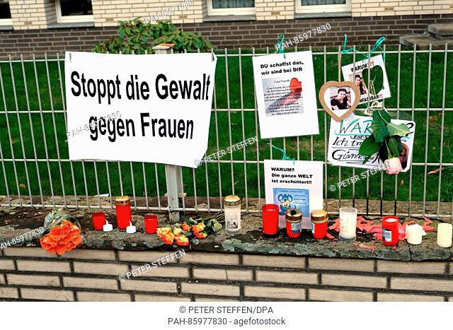 Candles, flowers and posters reading 'Stoppt die Gewalt gegen Frauen' (lit. 'Stop the violence against women') can be seen after the violent felony against a...